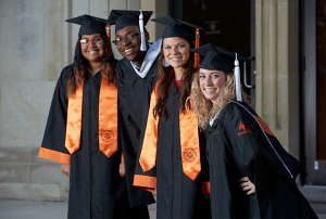Herff Jones Helps Graduates Graduate With A Cap And Gown That Matches Their School